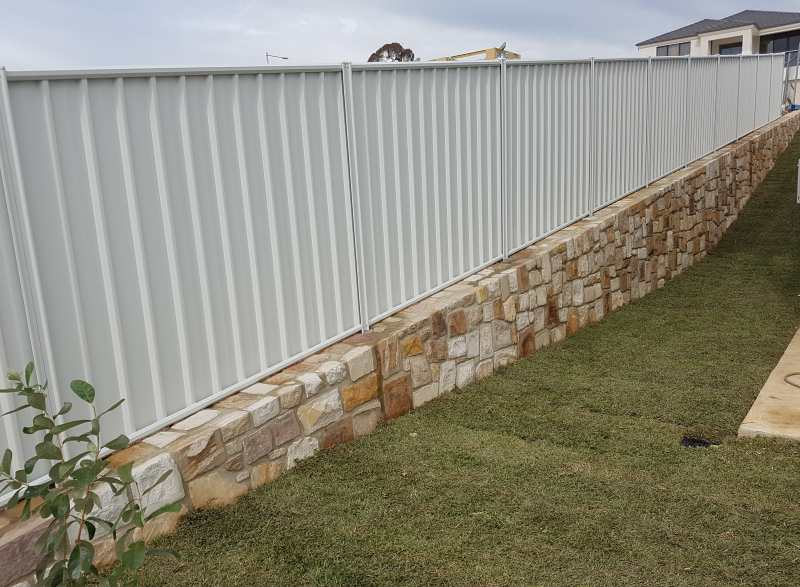 Colorbond with rock wall